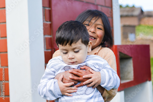 two latin siblings hugging outside stock photo and royalty free