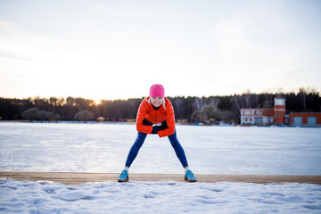 Picture of sports woman on morning exercise in winter