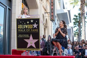 Eva Longoria listens as Felicity Huffman speaks on the Hollywood Walk of Fame in Los Angeles