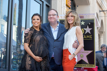 Eva Longoria, Marc Cherry and Felicity Huffman pose on the Hollywood Walk of Fame in Los Angeles