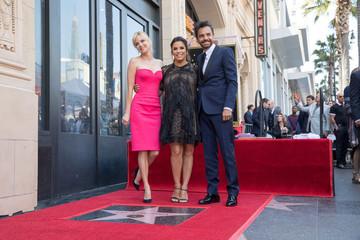 Anna Faris, Eva Longoria and Eugenio Derbez pose on the Hollywood Walk of Fame in Los Angeles
