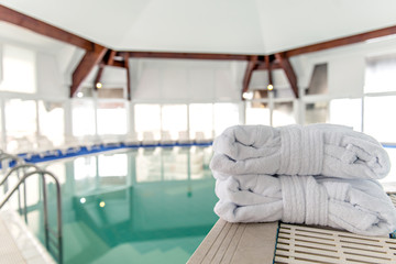 Bathrobe and towels next to swimming pool