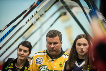 Laurie, Scott, and Jordyn Thomas leave the memorial for Evan Thomas, one of the players killed in the bus crash carrying the Humboldt Broncos Junior A hockey team, in Saskatoon