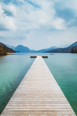 Wooden landing stage at alpine lake in summer