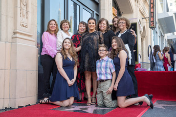Eva Longoria poses with her family on the Hollywood Walk of Fame in Los Angeles