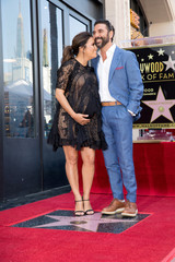 Eva Longoria and her husband Jose 'Pepe' Baston pose on the Hollywood Walk of Fame in Los Angeles