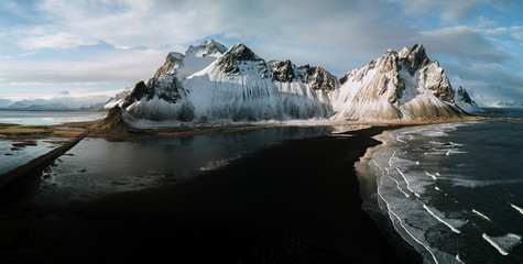 Panoramic aerial view of Stokksnes beach in Iceland during winter and epic sunset