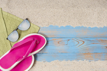 towel glasses and slippers on the beach for summer background