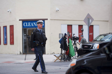 A police officer crosses the road as members of the media set up across the street from the Center City Starbucks, where two black men were arrested, in Philadelphia, Pennsylvania