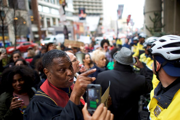 Rev. Gregory Holston, 56, and other interfaith clergy leaders march from the Center City Starbucks, where two black men were arrested, to other nearby stores in Philadelphia
