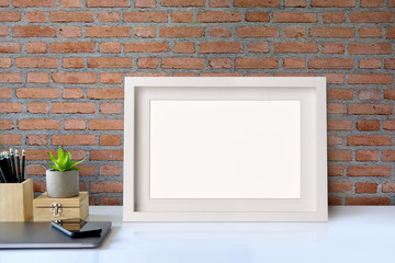 Stylish workplace poster mockup. workspace with artist supplies. workspace and copy space
