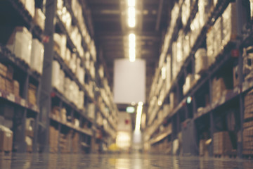 Blurry background of Warehouse inventory product stock for logistic background