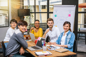 Portrait of Group Of Asian and Multiethnic Business people with casual suit in the modern Office, people business group concept