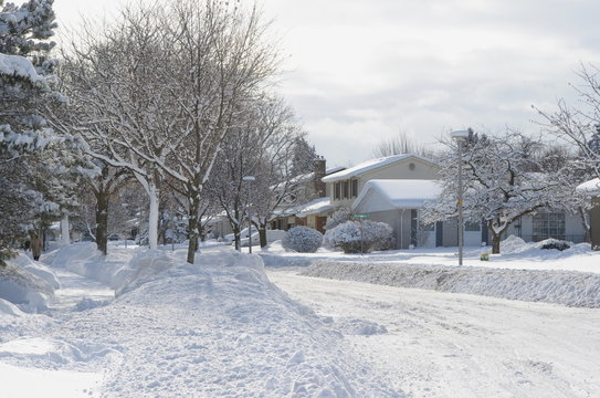 Heavy winter snow fall in Canadian residential area - snow covered streets on a bright sunny day