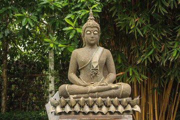 Artificial Buddha is in the garden. In the midst of the shady and cool in beautiful nature.