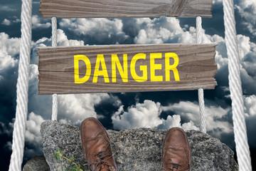 Challenging bridge with text Danger