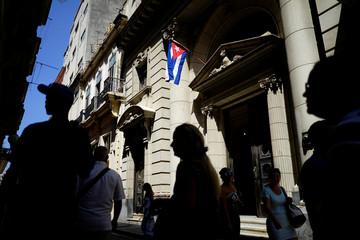 People walk on the street in Havana