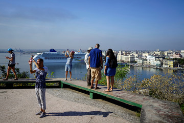 Tourists take pictures in Havana