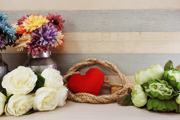 red heart symbol valentine's day concep background with flowers decoration