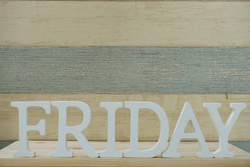 friday word decorative letters on wooden background