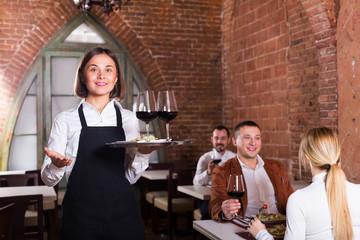Female waiter in country restaurant