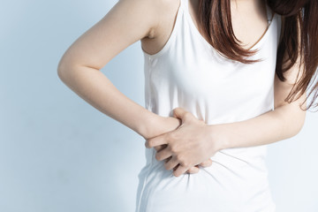 Woman in home with strong stomach menstruation pain