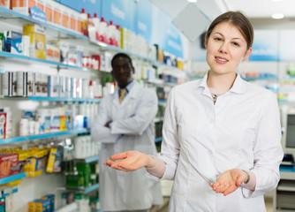 female pharmacist inviting to drugstore