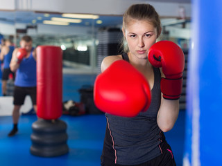 Portrait of  woman who is training in box gym.