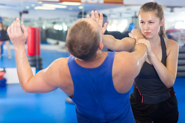 Positive woman is fighting with trainer