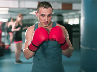Portrait of adult male who is boxing