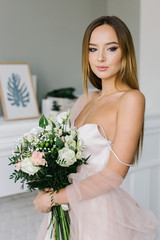 Young girl holds the bouquet