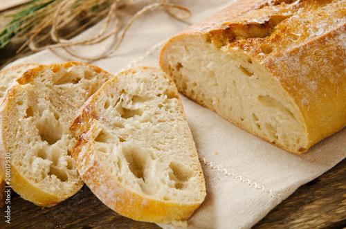 Ciabatta Bread Slices Of On Wooden Table Linen Cloth Rustic Style