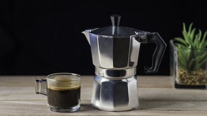 moka pot coffee cup isolated in dark background