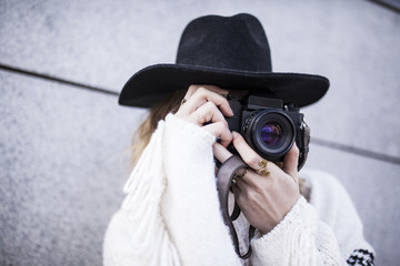 Pretty woman with camera on street