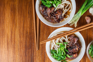 Japanese Udon noodles with beef, green onion and soup