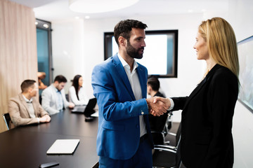 Portrait of business couple in conference room