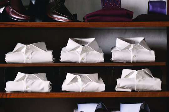 Portrait of a closet full of folded shirts, shoes and ties. Concept: Shop, tailor, fashion
