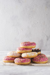 Stack of pink and white donats over white background