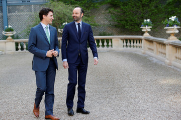 French Prime Minister Edouard Philippe and Canadian Prime Minister Justin Trudeau walk before a meeting at the Hotel Matignon in Paris