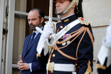 French Prime Minister Edouard Philippe waits for the arrival of Canadian Prime Minister Justin Trudeau  at the Hotel Matignon in Paris