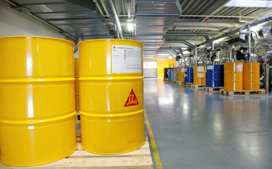 Barrels are seen at the plant of Swiss chemical group Sika in Duedingen