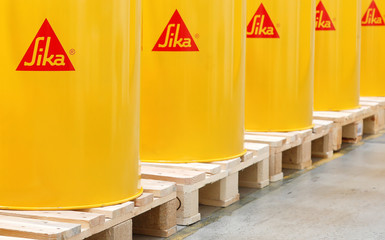 Logo of the company is seen on barrels at the plant of Swiss chemical group Sika in Duedingen