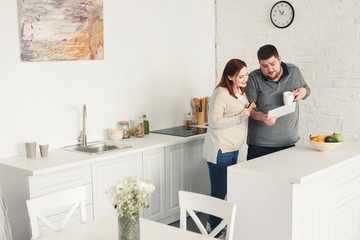 boyfriend and girlfriend shopping online in kitchen