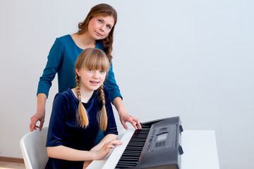 Girl playing synthesizer