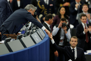 French President Emmanuel Macron shakes hands with European Parliament President Antonio Tajani after his speech before a debate on the Future of Europe at the European Parliament in Strasbourg