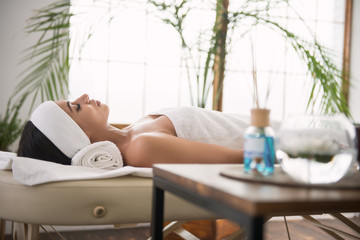 I am ready. Pleasant relaxed woman lying on the bed and waiting for the massage in the spa salon