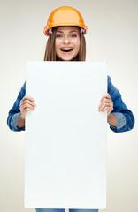 Woman builder holding white advertising banner, billboard, sign