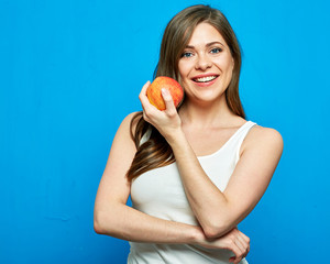 Smiling woman holding red apple. Toothy smile.