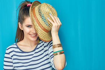 Teenager girl hide face behind hipster hat.