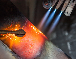 Heated steel with flame gas